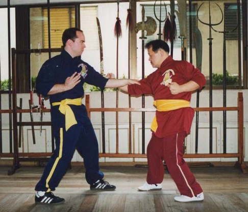 Dr. Mark Wiley and GM Alex Co performing the two-man set of Sang Sau Kun.